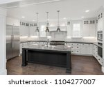 beautiful kitchen in new luxury ... | Shutterstock . vector #1104277007