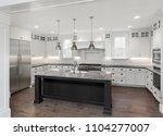 beautiful kitchen in new luxury ... | Shutterstock . vector #1104277007