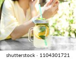 mason jar with tasty lemonade... | Shutterstock . vector #1104301721