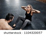 fit young woman doing crunchees ... | Shutterstock . vector #1104320057