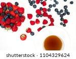 big pile of fresh berries...   Shutterstock . vector #1104329624