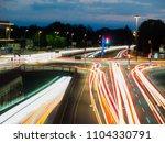 car traffic at night in neu ulm ... | Shutterstock . vector #1104330791
