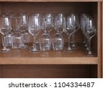 glasses on a shelf in a... | Shutterstock . vector #1104334487