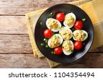 stuffed deviled eggs with tuna... | Shutterstock . vector #1104354494