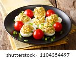 delicious snack  stuffed eggs... | Shutterstock . vector #1104354497