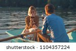young couple with a glass of... | Shutterstock . vector #1104357224