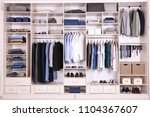 large wardrobe with different... | Shutterstock . vector #1104367607