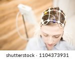 young female with electrode... | Shutterstock . vector #1104373931