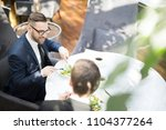 businessman and his colleague... | Shutterstock . vector #1104377264