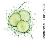cucumber slices rotate in... | Shutterstock . vector #1104379211