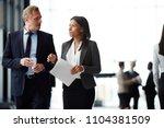 two intercultural colleagues in ... | Shutterstock . vector #1104381509