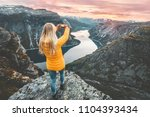 woman taking photo by... | Shutterstock . vector #1104393434