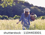 woman with straw hat is holding ... | Shutterstock . vector #1104403001