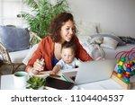 attractive young dark skinned... | Shutterstock . vector #1104404537