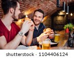 two happy male friends having... | Shutterstock . vector #1104406124