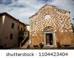 church in asciano  tuscany ... | Shutterstock . vector #1104423404