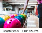 rack of colorful balls at a... | Shutterstock . vector #1104423695