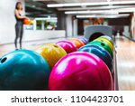 rack of colorful balls at a... | Shutterstock . vector #1104423701