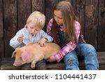charming farmer's children...   Shutterstock . vector #1104441437