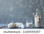 almond milk in glass with nut... | Shutterstock . vector #1104455357