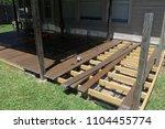 building a backyard deck with... | Shutterstock . vector #1104455774