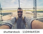 handsome man tourist taking a... | Shutterstock . vector #1104464534