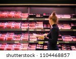woman purchasing a packet of... | Shutterstock . vector #1104468857