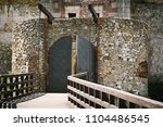 main entrance to the castle of... | Shutterstock . vector #1104486545