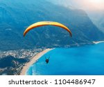 paragliding in the sky.... | Shutterstock . vector #1104486947
