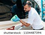boat maintenance   a man... | Shutterstock . vector #1104487394