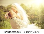 groom and bride in a park.... | Shutterstock . vector #110449571
