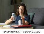 student comparing energy drink... | Shutterstock . vector #1104496109