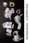 Stock photo wonderland background mad tea party cups teapot and playing cards falling down the rabbit hole 1104501221