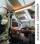 industrial robot is welding... | Shutterstock . vector #1104504629