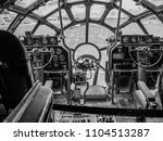black and white photo of the cockpit of a B29 superfortress airplane.