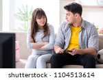 family pair watching football... | Shutterstock . vector #1104513614