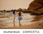 happy two little girls have fun ... | Shutterstock . vector #1104515711