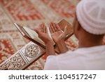 top viewv of african muslim man ... | Shutterstock . vector #1104517247