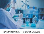 science laboratory dropper on... | Shutterstock . vector #1104520601