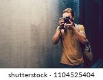 street photographer journalist... | Shutterstock . vector #1104525404