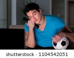 young man watching football... | Shutterstock . vector #1104542051