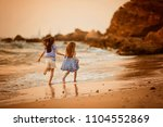 two sisters playing on the... | Shutterstock . vector #1104552869