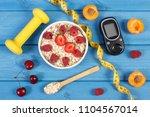 glucometer  fresh oat flakes... | Shutterstock . vector #1104567014