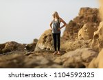 young woman standing on the top ... | Shutterstock . vector #1104592325