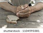 hands the poor old man's  piece ...   Shutterstock . vector #1104593381