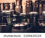 camera lens in shop vintage... | Shutterstock . vector #1104610124