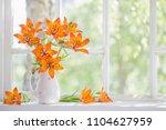 orange lily on windowsill | Shutterstock . vector #1104627959