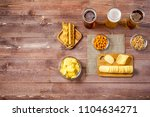 glasses of light and dark beer...   Shutterstock . vector #1104634271