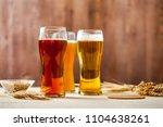 glasses of assorted beer with...   Shutterstock . vector #1104638261