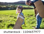 happy toddler boy playing... | Shutterstock . vector #1104657977